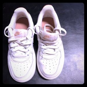 Little girl Nike Air Force Ones with rose gold